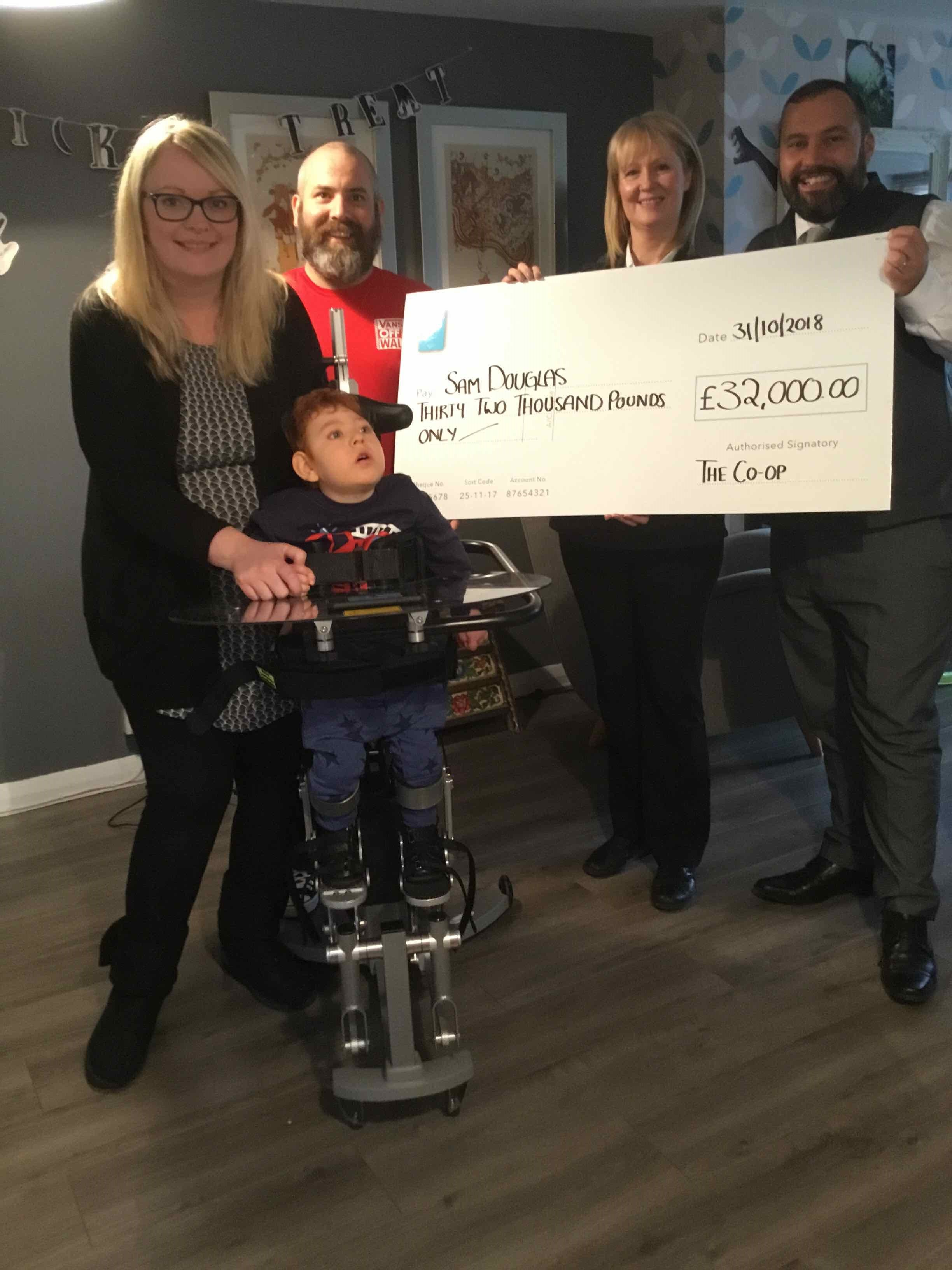 19 Co-op Stores across the Highland and Islands raise £32,000 for local boy